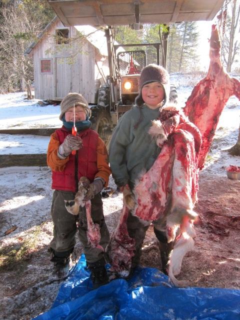The boys honing their skills on a roadkill deer, circa 2010